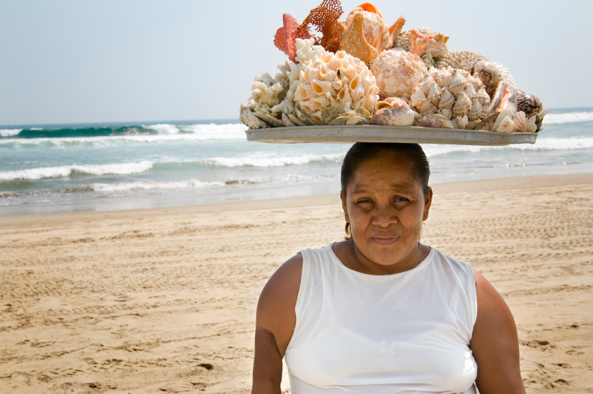 Woman harvesting from the ocean in Mexico