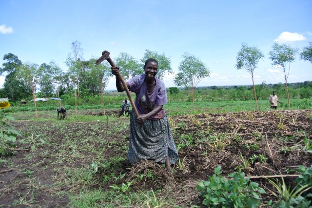 Ugandan woman in community garden